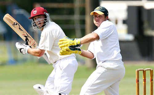 Glasshouse wicketkeeper Brett Milini looks on as Caboolture's Clayton Simpson late cuts.
