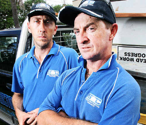 Builders Steve Sampson and Scott Chandler are not happy that insurers are using interstate builders as their preferred builders for flood damaged Ipswich homes.