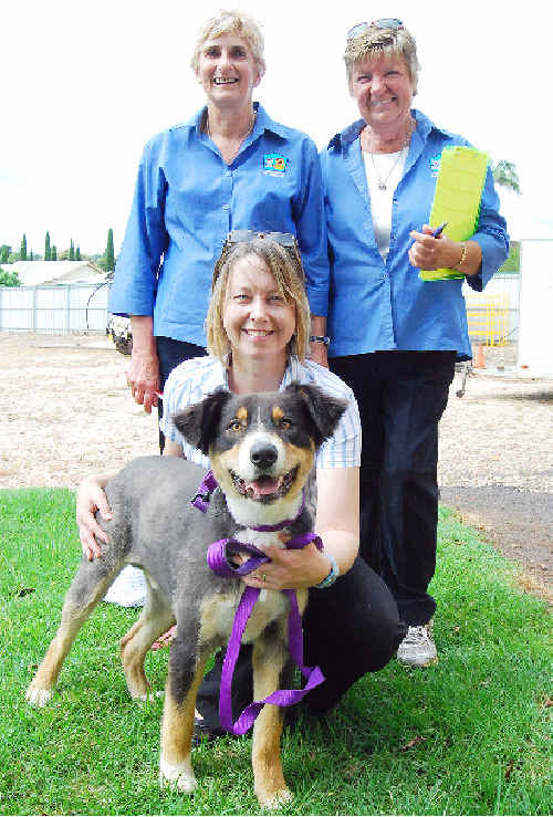 Roy and owner Gail Mackney, of Nashua, are congratulated on passing the suitability test for the school program by Responsible Pet Ownership Education Program testers Jenny Ralph and Lea Cogley.