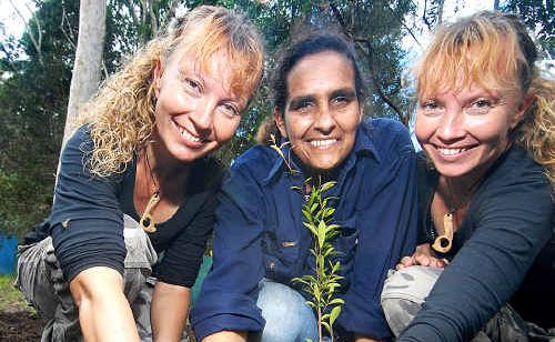 Beverly Hand helps Bridgette and Paula Powers plant trees at their new seabird rehabilitation park, Twinnies.
