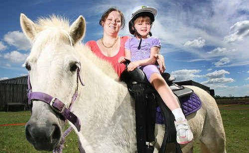 Rett Syndrome sufferer Holly Butler had Harmony the pony donated when her previous pony Angel was taken from her during the flood. Mum Kerrie helps Holly get aquanted with her new friend.
