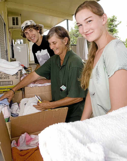 Volunteering at the Grantham food distribution centre are (from left) Cody Purton, Debbie Middleton and Casey Van Zelst.