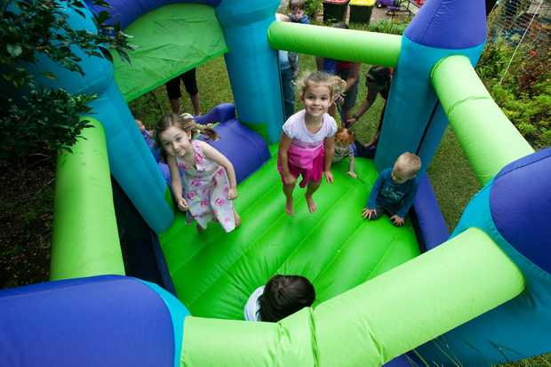 Coffs Harbour playgroup kids enjoy the mini-jumping castle at their open day on Monday.