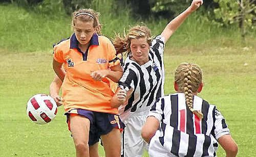North Coast's Brontie Barrera beats her Mid North Coast rivals to the ball during their clash at the weekend.
