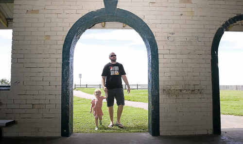 Terrigal holidaymaker Dan Ferris, with his daughter Addison (3), believes the Lennox Head foreshore shelter needs a revamp.