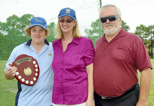 WORTHY WINNER OF A WORTHY AWARD: Todd Winsor (left) receives the Steven Lee Memorial Trophy for outstanding sportsmanship for his umpiring in season 2011 from Nerida and David Lee. SUBMITTED
