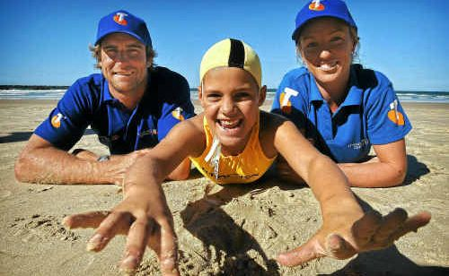 Champion lifesavers Zane Holmes and Alyce Bennett, with NSW state titles medal winner Jordan Elabassi, presented Yamba Surf Life Saving Club with an $8500 donation.