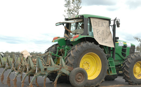 A LOCAL MAN CONVEYS his message of frustration when he blocked the Millers Road/Gatton-Esk Road intersection last week.