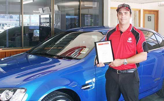 SALES LEADER: Crossley Holden's Ben Hancock with his outstanding sales achievement award.