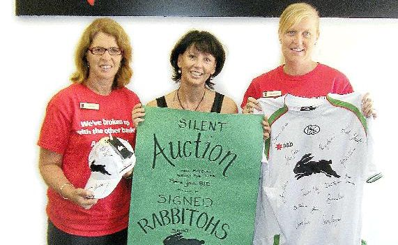 Relay for Life committee members Janine Zietsch, Michelle Gillies and, Rebekah Teni show off the Rabbitohs jersey that will be auctioned off in the next week.