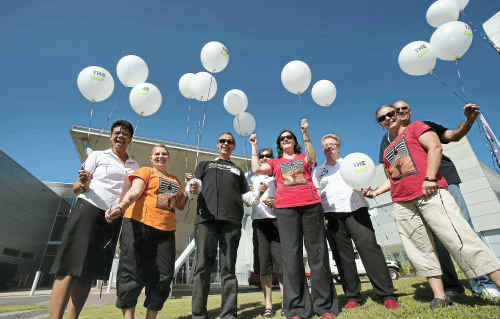Representatives from Galambila AHS and the Coffs Harbour Education Campus gather to mark National Close the Gap Day.