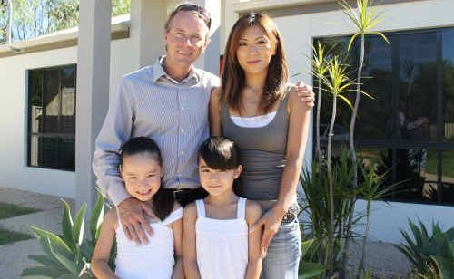 David and Kai Delahunty with daughters Hana and Takara are waiting on good news from Sendai, Japan.
