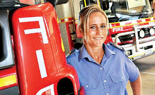 The State Government wants more women firefighters like former ironwoman Kirsty Holmes to join the service.