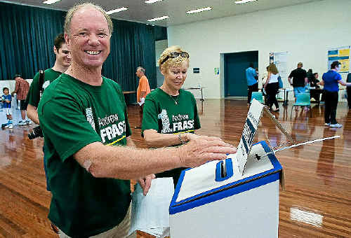 Andrew Fraser, his wife Kerrie and son Angus vote at the Coffs Harbour Showgrounds booth on Saturday.