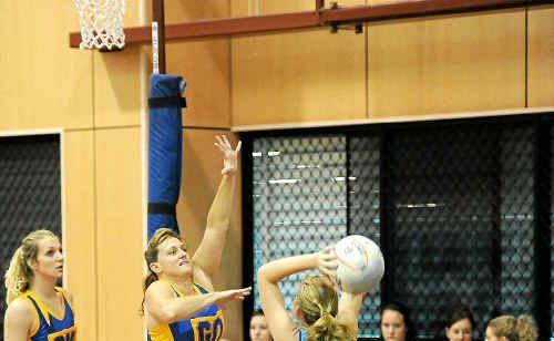 Sharyn Batt of ATW Gold defends her goal against Alloway Purple's goal attack Courtney Ram.