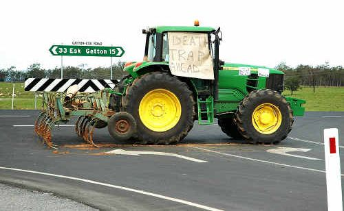 "Lockyer Valley resident Rick Stevens parked his tractor at a T-intersection on Gatton-Esk Rd and Millers Rd to warn motorists of the ""death trap""."
