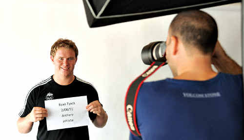 Local archer and Olympic hopeful, Ryan Tyack, gets his mug shot taken at the 2012 Australian Olympic team processing session at the Mooloolaba SLSC.