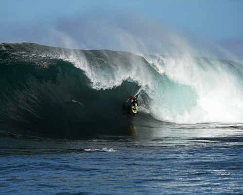 Dean Morrison getting barrelled during one of his many sessions in the surf.