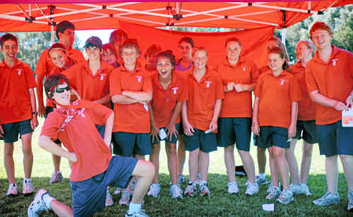 Kallatina House students take a break at the school cross-country carnival on Thursday.