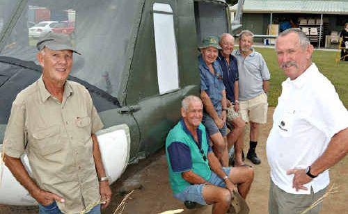 Caloundra Air Museum volunteers refurbish a Huey helicopter that will be exchanged for an Iroquois.