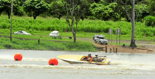 Hot Lemon driven by Andrew Goodhew spins around the marker buoys at the Bundaberg Power Boat Club Fun Day.