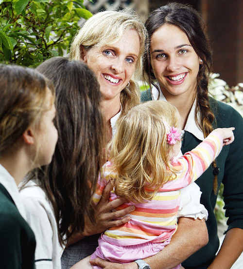 Mother of the Year finalist Michelle Covele with her natural daughter Simone and foster daughters.