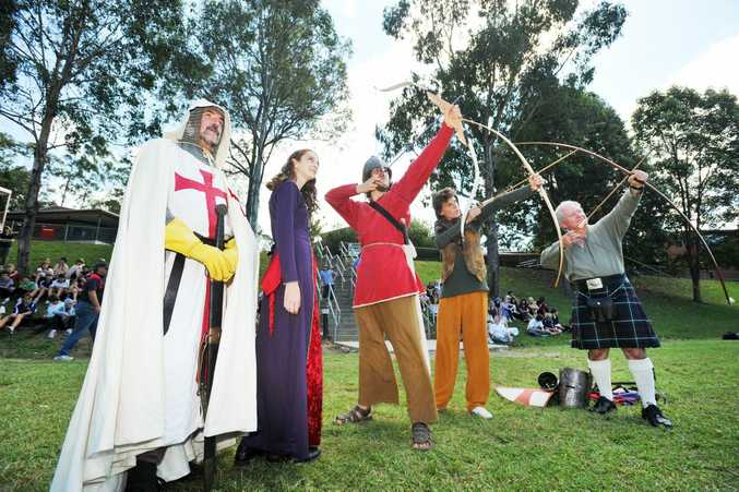 Celtic Thunder teach BDC students Lilly Batley, Josh Wilson-Douglas and Sam Holland about archery during the school's medieval day on Thursday.