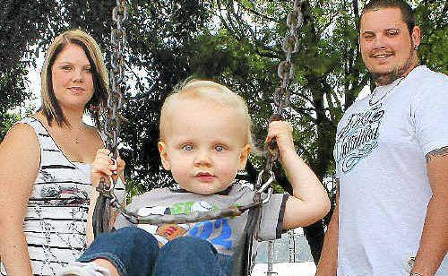 Vanessa, Maverick, 20 months, and Sebastian Fear at play in Cameron Park, Maclean.
