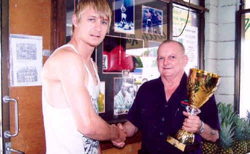 Robbie Dunnett (right) presents PCYC boxer Lachlan Hinchcliffe with the prize for winning the Fight of the Night at the Rockhampton PCYC's boxing tournament.