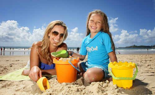 Dee Clarke with her five-year-old daughter, Tilly, enjoy a brief break at Mooloolaba beach.