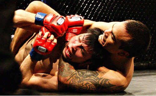 Ryan Dunstan of Advance MMA puts a hold on Shinya Irei of Japan.