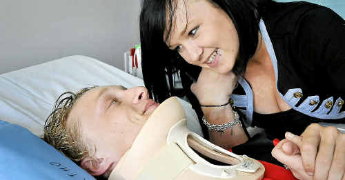 Jack Bishop is supported by older sister Tegan at the Toowoomba Hospital yesterday after he was injured in a TRL under 18s game between Valleys and Wattles at Clifton's Platz Oval on Sunday.