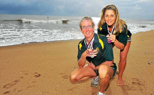 Moore Park Surf Lifesaving Club's Julie Davis and Joanna Tolvanen with their medals from the recent State Lifesaving Championships.