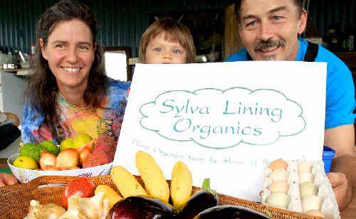 Sylva Oberholster, Lara Willis and Ian Willis with produce they will sell at the Caldera Farmers Market.