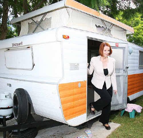 Julia Gillard drops by a flood victim's caravan in Goodna.