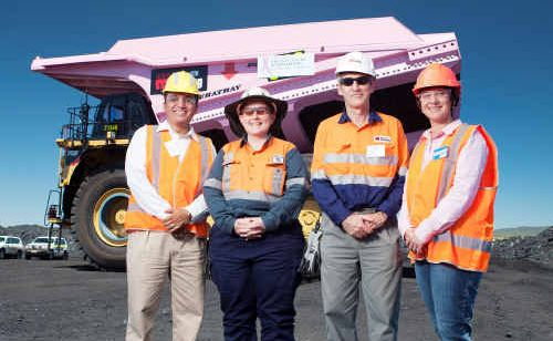 Marco Medel, Jen Mackenzie, Peter Connor and Fiona Welsh at the launch of the bright pink haul truck at Norwich Park Coal Mine.