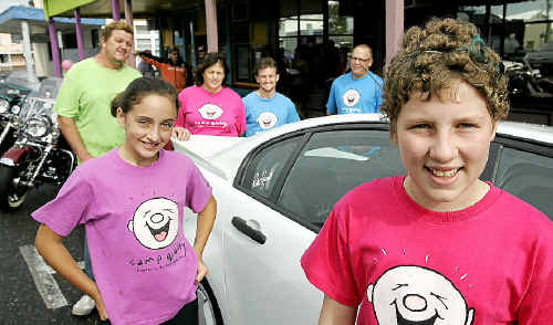 Alex Thomson, 11, and Grace Griffin, 12, with Camp Quality supporters promoting this weekend's Fun On Wheels Camp Quality Charity Motor Cruise.