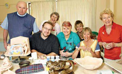 CRAFTY LOT: Don Nolan, Curtis Marrett, Heather Davis, Sharon Hanson, Allison Ravaioli, Min Mahoney and Audrey Marshall have a community of interest at the Petrie Park Craft Association.