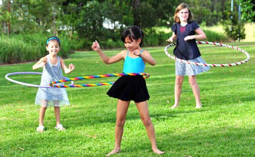 Hanae and Mei-Mei Tan and Lulu Maloney get in some practice for a hula hooping workshop at Peregian Community Centre.