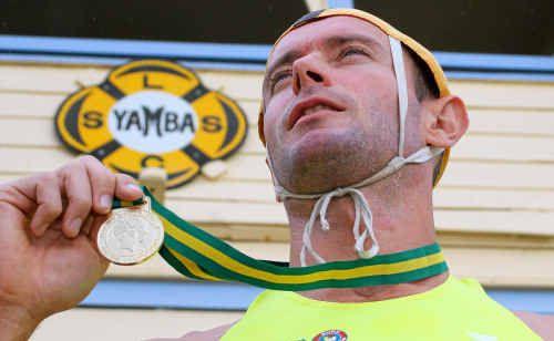 Yamba Surf Club member Ben Plunkett with the 2km beach run gold he won at the Australian Surf Life Saving titles.