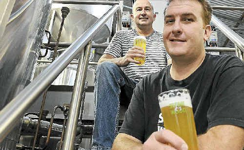 Stone and Wood brewers Brad Rogers (front) and Jamie Cook at their Byron Bay brewery, enjoying a drop of the beer that had been voted Australia's best.