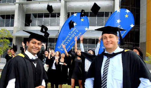 International SCU students Vibert Fernandes and Thomas Moll celebrate their graduation ceremony.