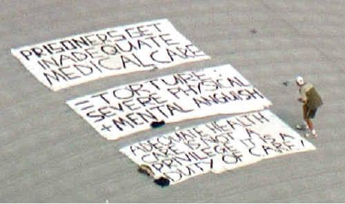 Gerard Richmond-Sinclair's sign on the roof of Borallon Correctional Centre. Photo: TEN News