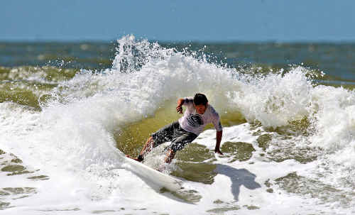 Riding this wave to victory is Yeppoon's Brett Murray, a local surfer competing against old friends on a beach he knows and loves, to win the Yeppoon Surfing Festival at the weekend.