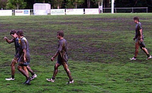 Gympie Devils under 18 players leave a muddy Crusher Park.
