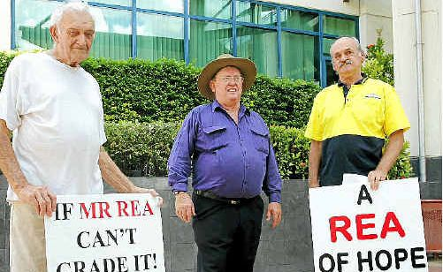 Allen Rea (middle) flanked by two of his supporters, Bill Steel and Keith Kelley, outside the courthouse.