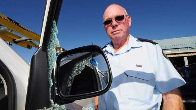 Bob White examines the damage from the break-in at the SES headquarters.