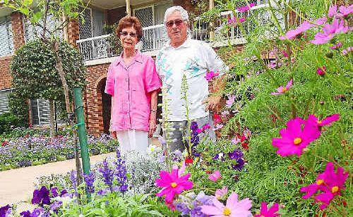 Joy and Noel Baldwin in their Jacaranda garden.