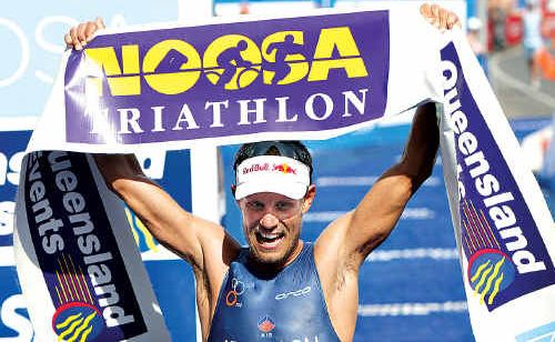 Courtney Atkinson celebrates his third win straight win at the Noosa Tri.