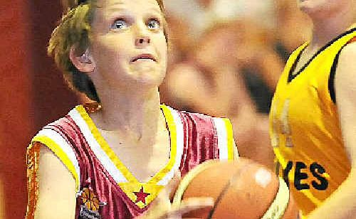 Under-12 Bundy Bulls rep team player Bailey Jenkins keeps focused on the basket in the grand final against under-14 Lakers at WIN Stadium.